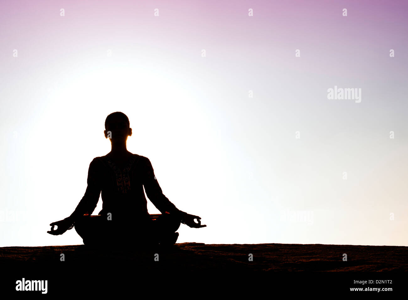Silhouette of an Indian girl meditating. Andhra Pradesh, India - Stock Image