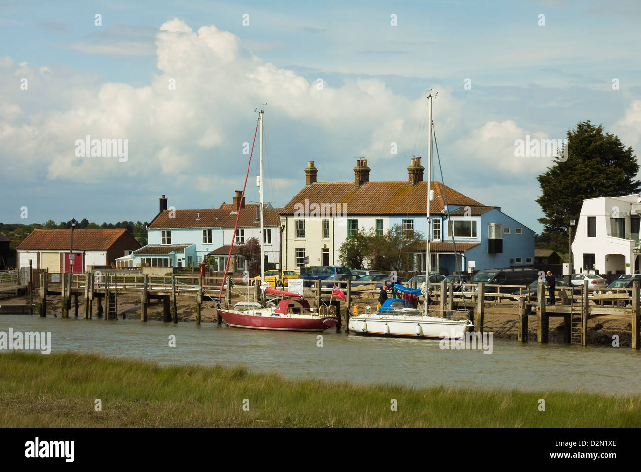 Looking across River Blyth towards houses and moored yachts on the Southwold bank, Walberswick, Suffolk, England, Stock Photo