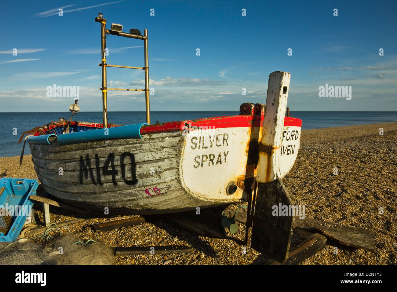Fishing boat and nets on the seafront shingle beach of this popular unspoiled seaside town, Aldeburgh, Suffolk, - Stock Image