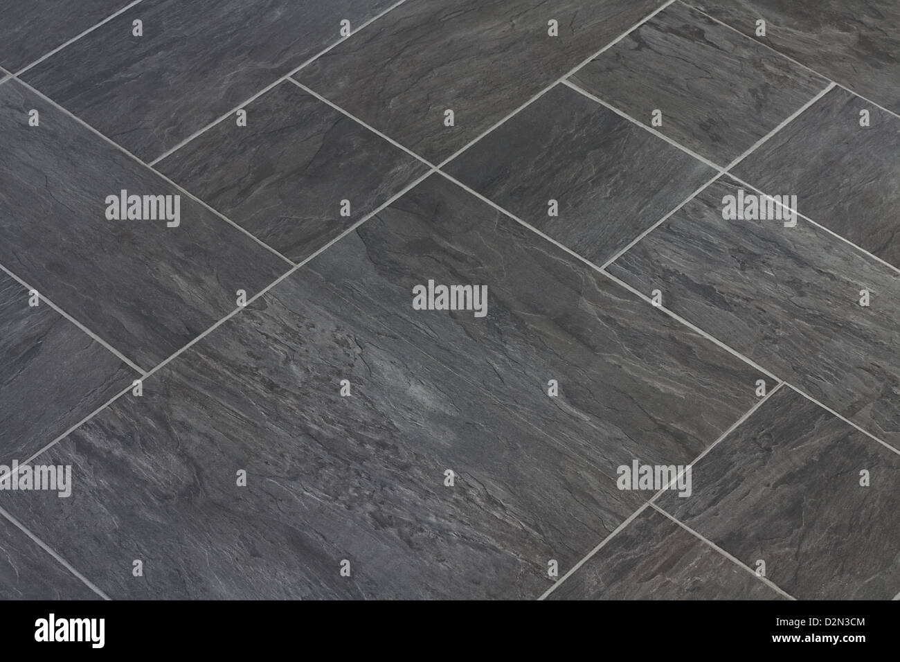 Slate texture vinyl flooring a popular choice for modern kitchens and bathrooms - Stock Image