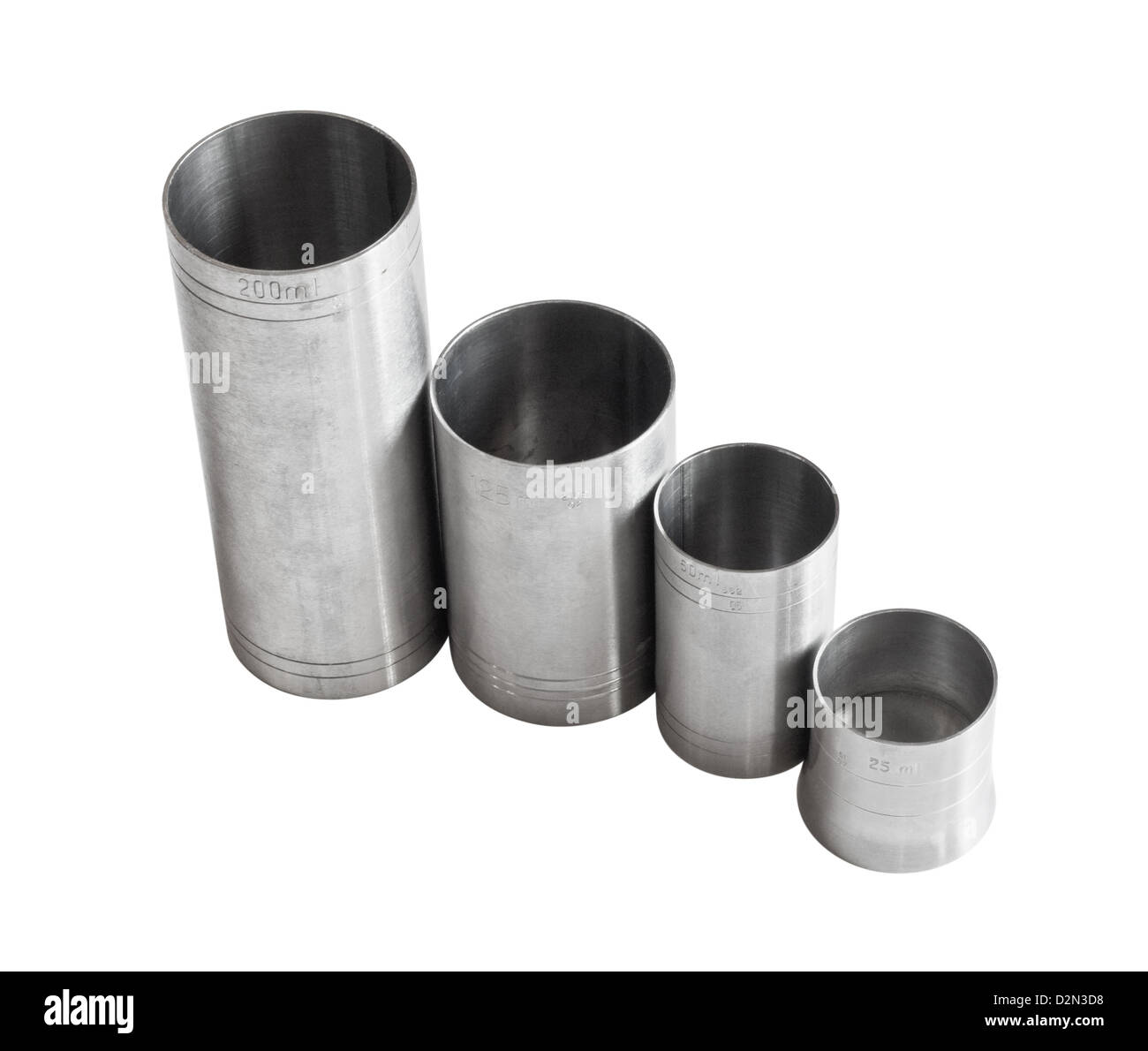 selection of metric thimble measures for serving alcohol in public bars good for graph showing decline in drinks Stock Photo
