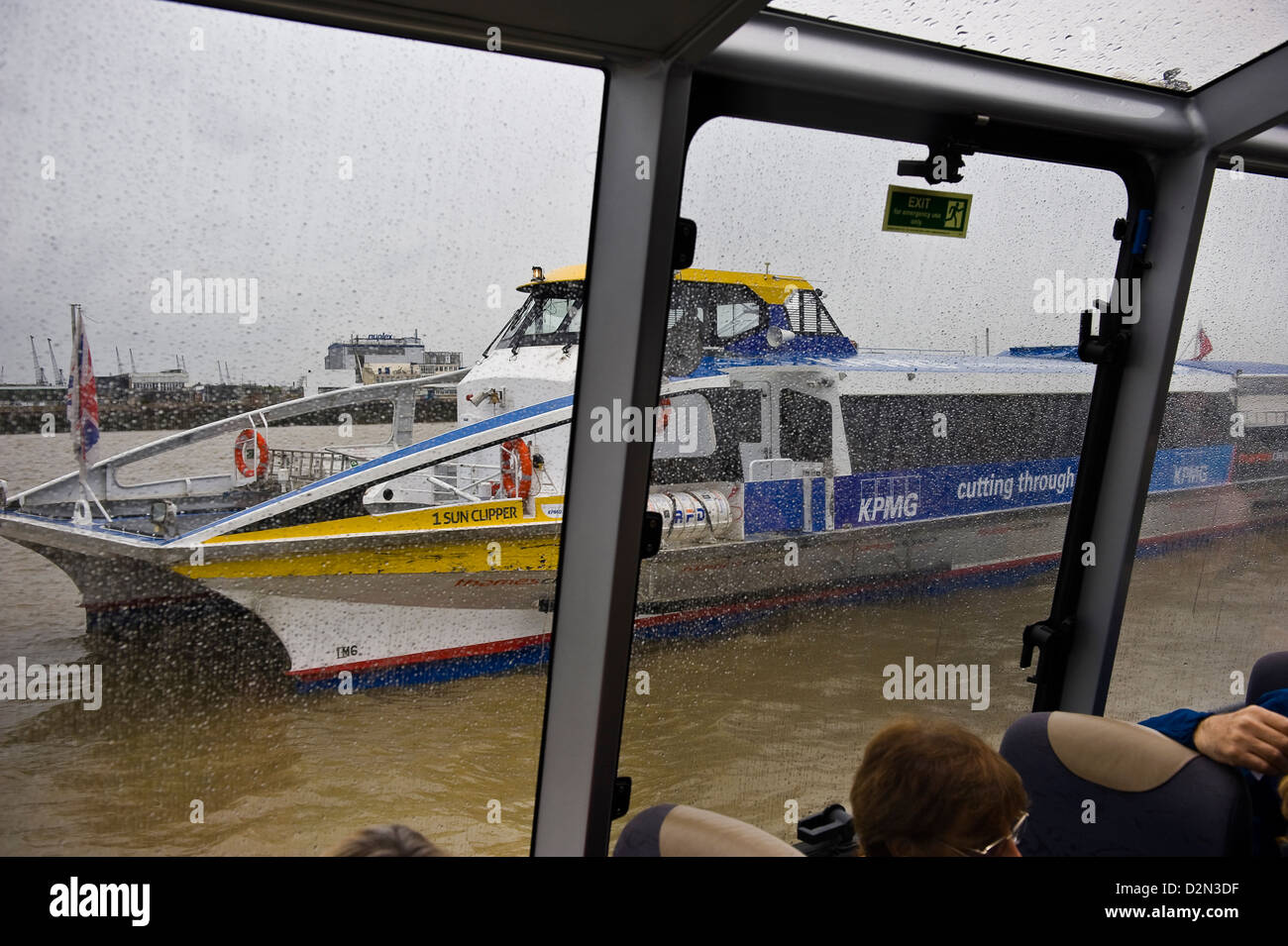 A Thames Clipper docking at Greenwich Peninsula, London, UK - Stock Image