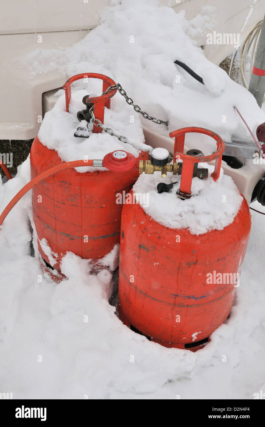 Caravan in an all season caravan park photographed during january's snow fall, Propane gas -bottle used use - Stock Image