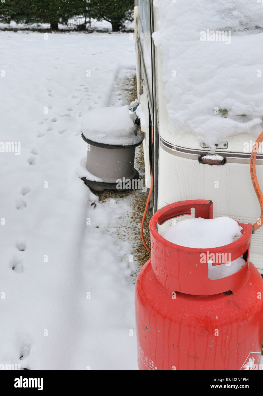 Propane gas /water tank supplying caravan in an all season caravan park photographed during january's snow fall - Stock Image