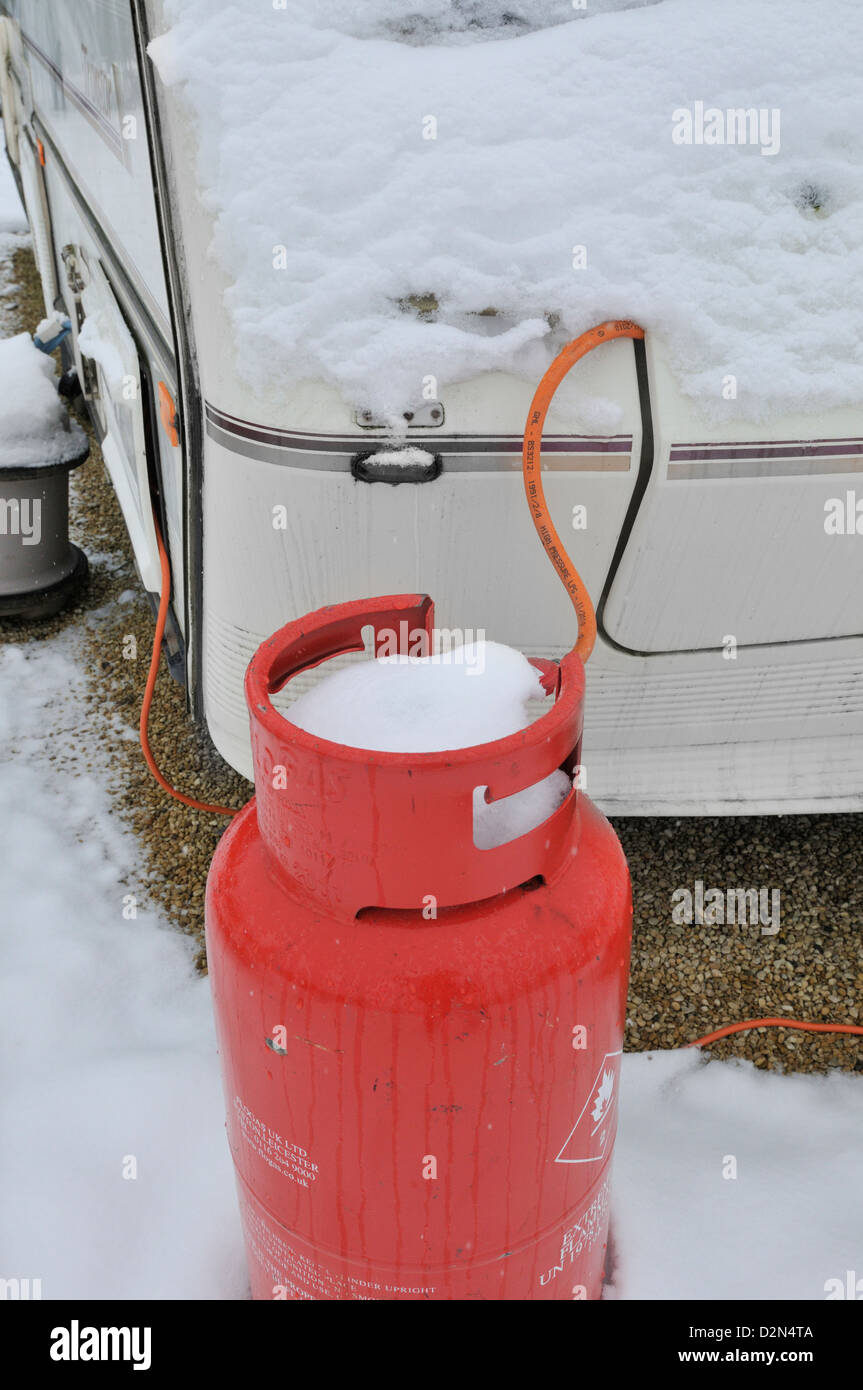 Propane gas for supplying caravans in an all season caravan park photographed during january's snow fall - Stock Image