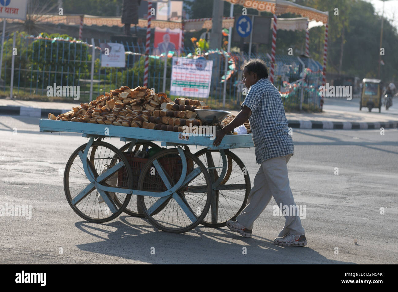 Selling varieties of bread on a push cart, Gujarat, India, Asia - Stock Image