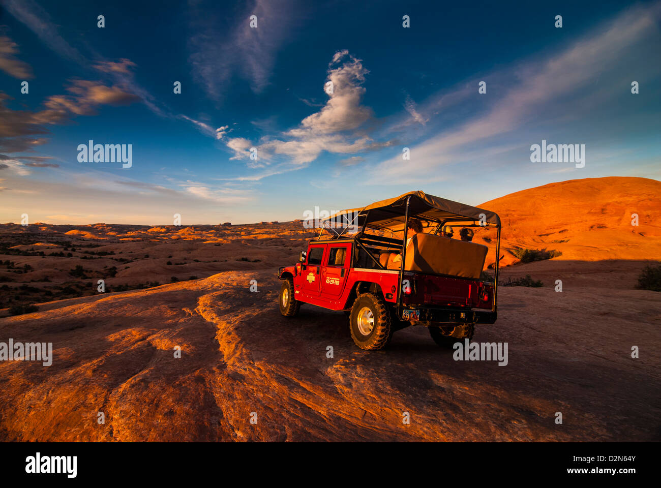 Hummer jeep on the Slickrock Trail at sunset, Moab, Utah, United States of America, North America - Stock Image