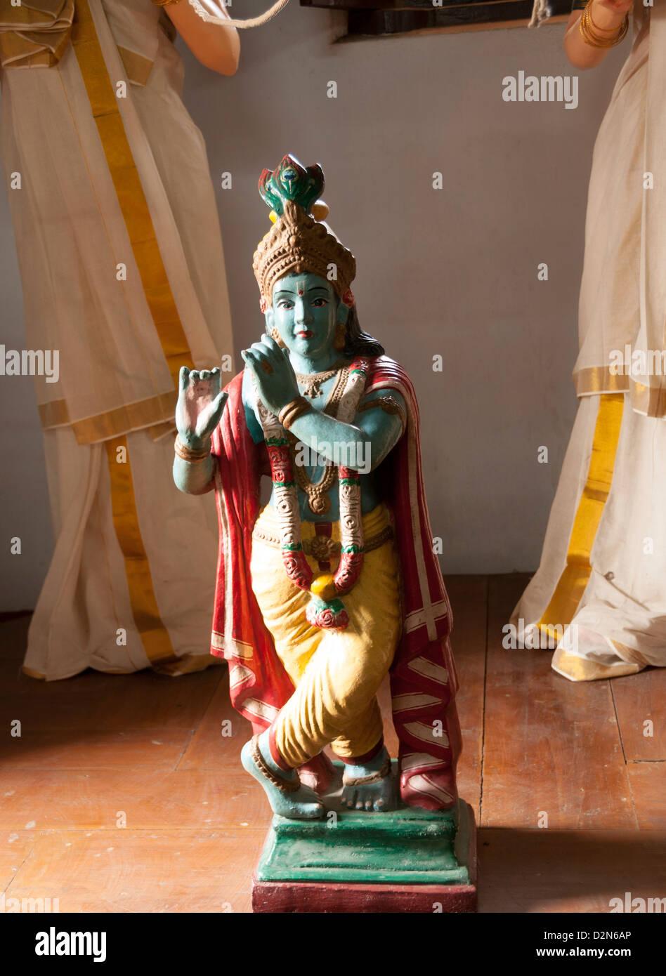 Deity  of Krishna playing flute - Stock Image