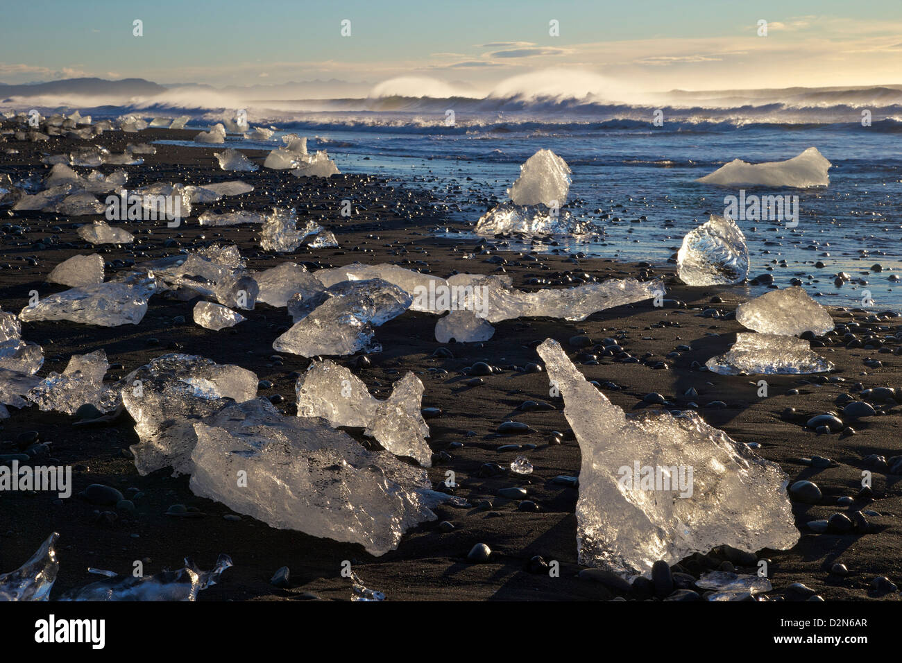 Icebergs on volcanic sand beach at Jokulsarlon, Iceland, Polar Regions - Stock Image