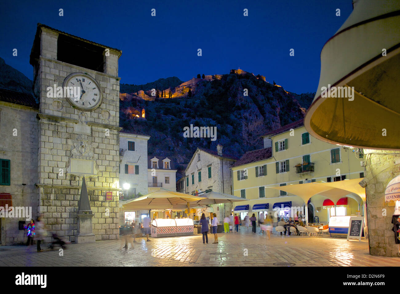 Old Town Clock Tower and Fort at dusk, Old Town, UNESCO World Heritage Site, Kotor, Montenegro, Europe - Stock Image