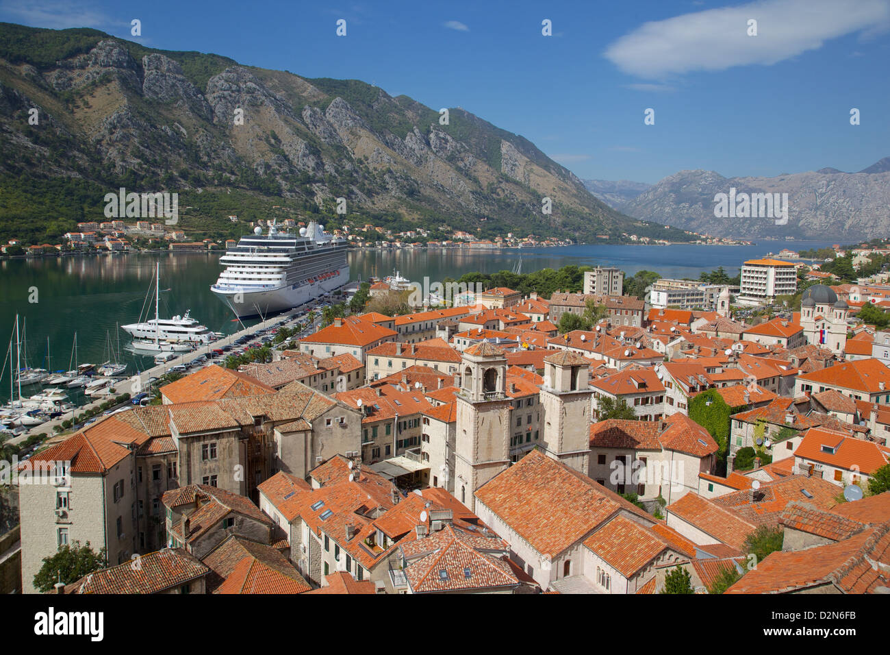 View over Old Town, UNESCO World Heritage Site, with cruise ship in port, Kotor, Montenegro, Europe - Stock Image
