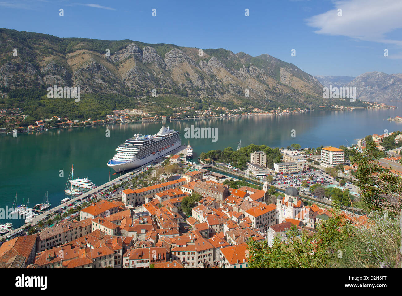 View over Old Town and cruise ship in Port, Kotor, UNESCO World Heritage Site, Montenegro, Europe - Stock Image