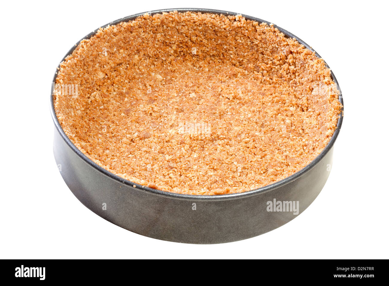 Biscuit base lining a loose bottomed tin - Stock Image