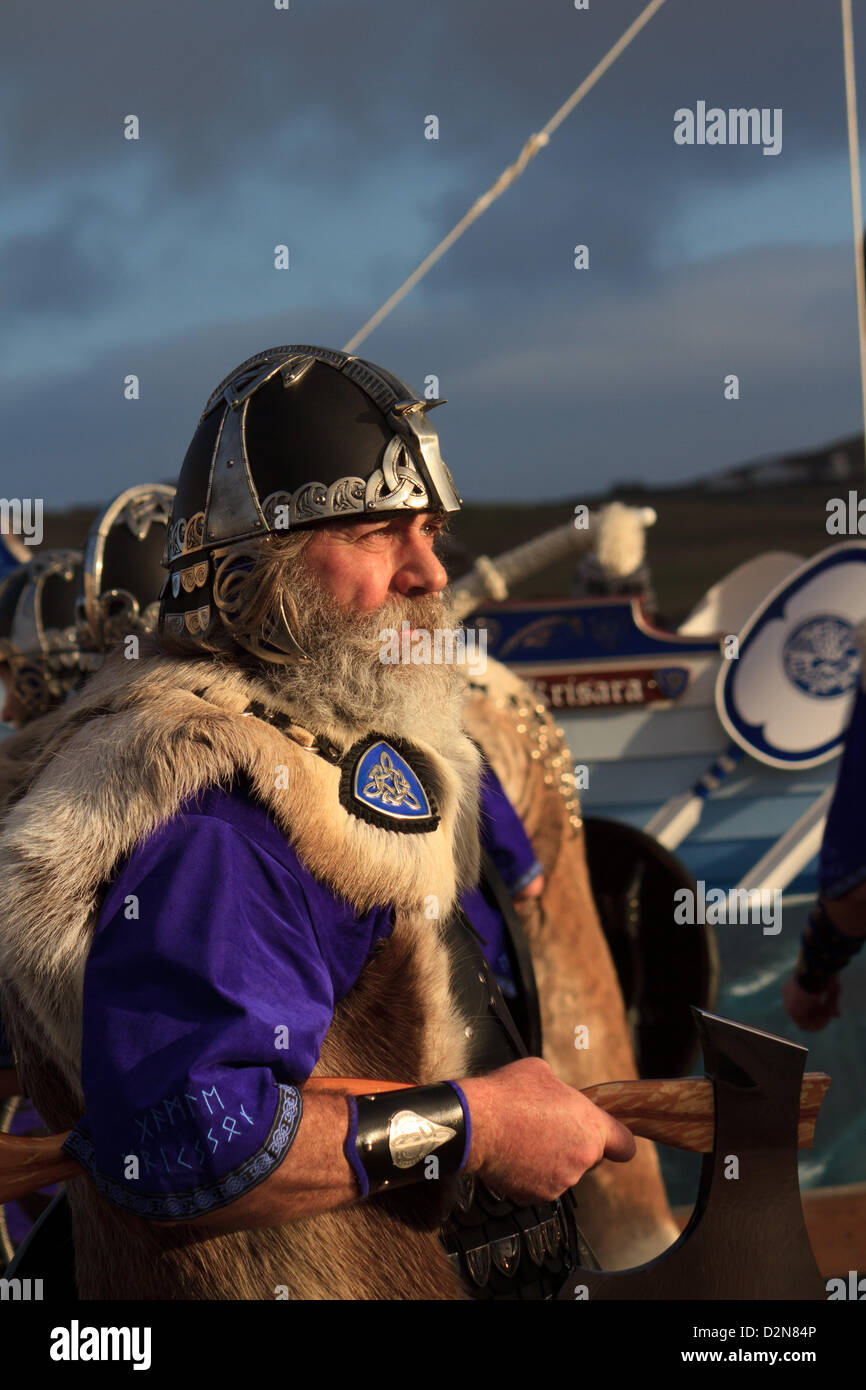 Shetland, Scotland, UK. Tuesday 29 January 2013.  One of the guizer jarl (chief viking) squad in full suit during Stock Photo