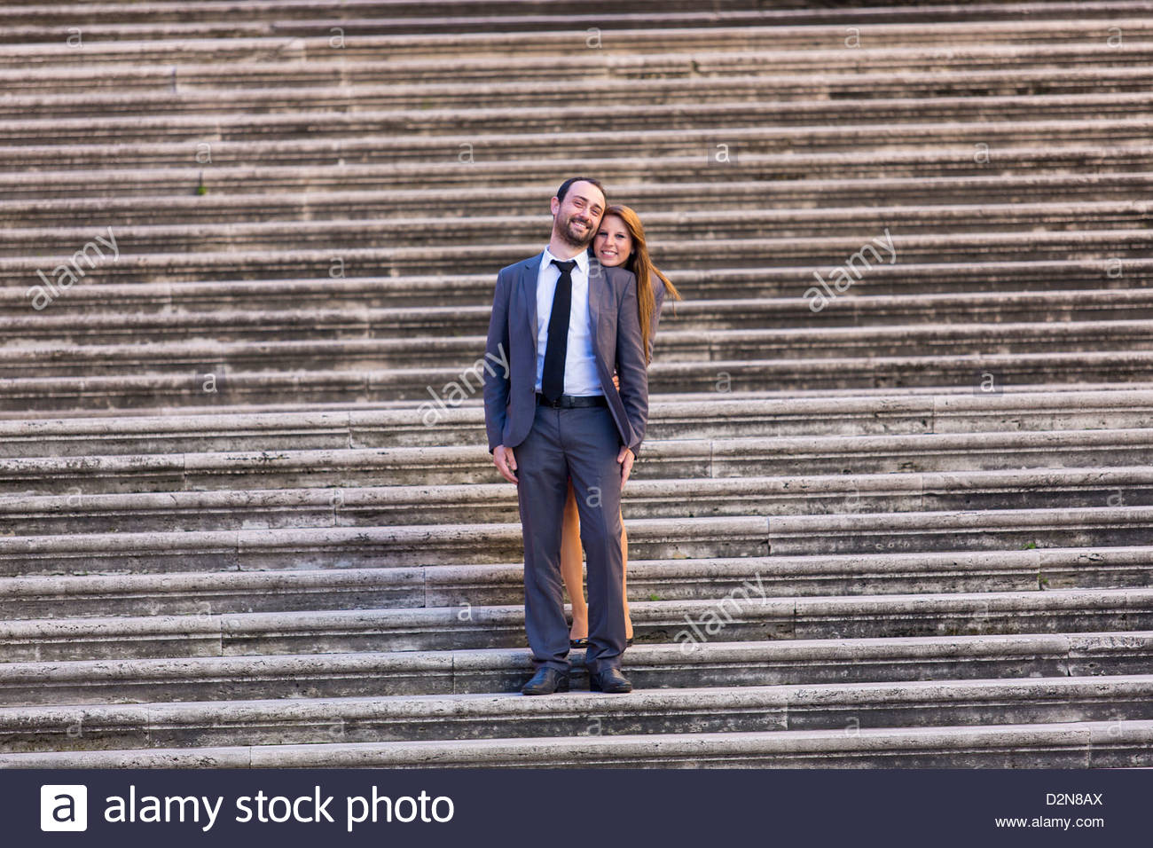 couple posing on a staircase - Stock Image