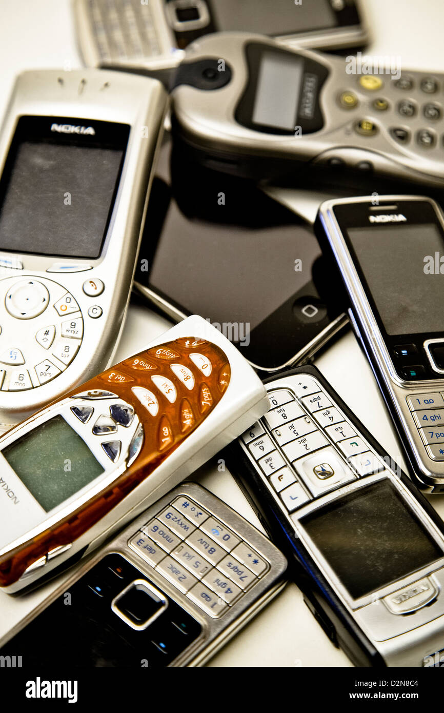 Studio shot of a collection of old Mobile Phones - Stock Image