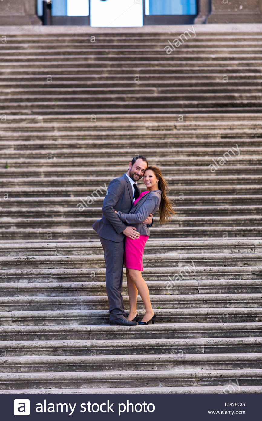 Couple posing together on the a staircase - Stock Image