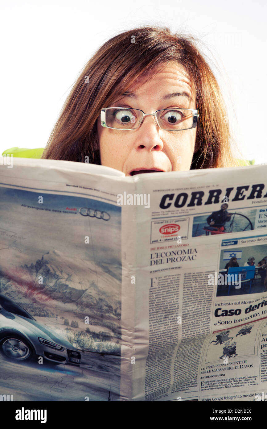 https://c8.alamy.com/comp/D2NBEC/middle-aged-woman-reading-surprising-news-in-the-newspaper-D2NBEC.jpg