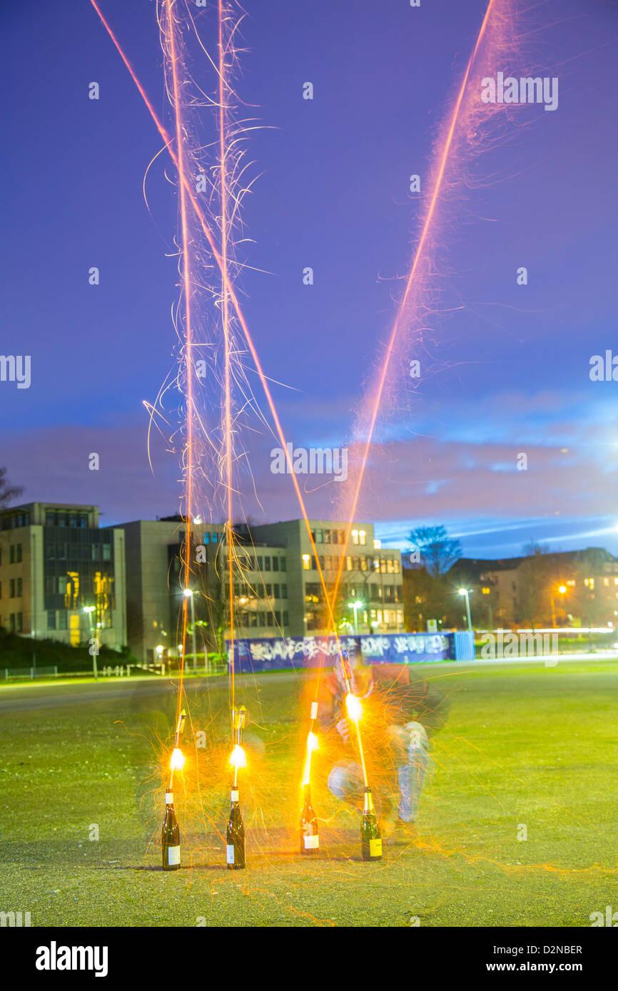 Launching a fireworks rocket. Stock Photo