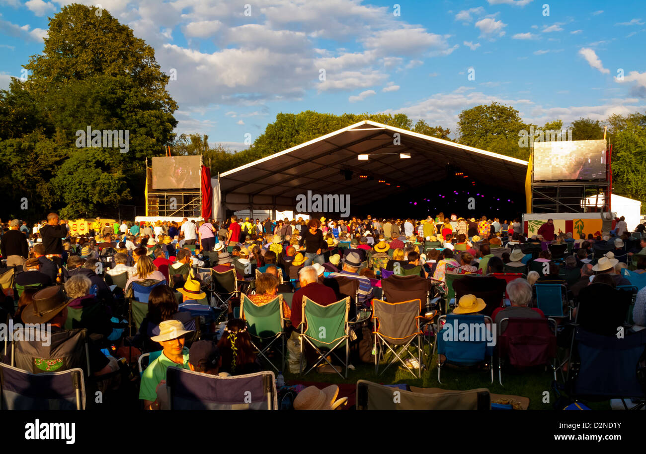 Cambridge Folk Festival audience at the summer roots music event held annually at Chery Hinton Cambridge England - Stock Image