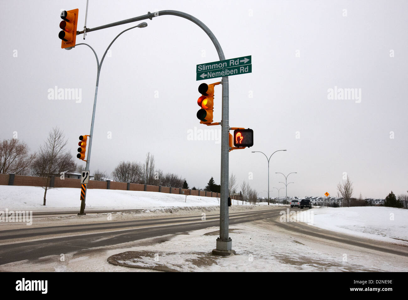 traffic lights intersection main road during freezing winter weather Saskatoon Saskatchewan Canada - Stock Image