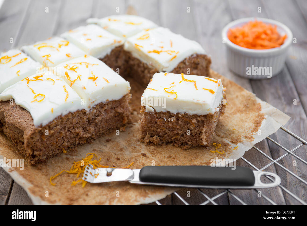 Carrot cake on a baking tray. - Stock Image