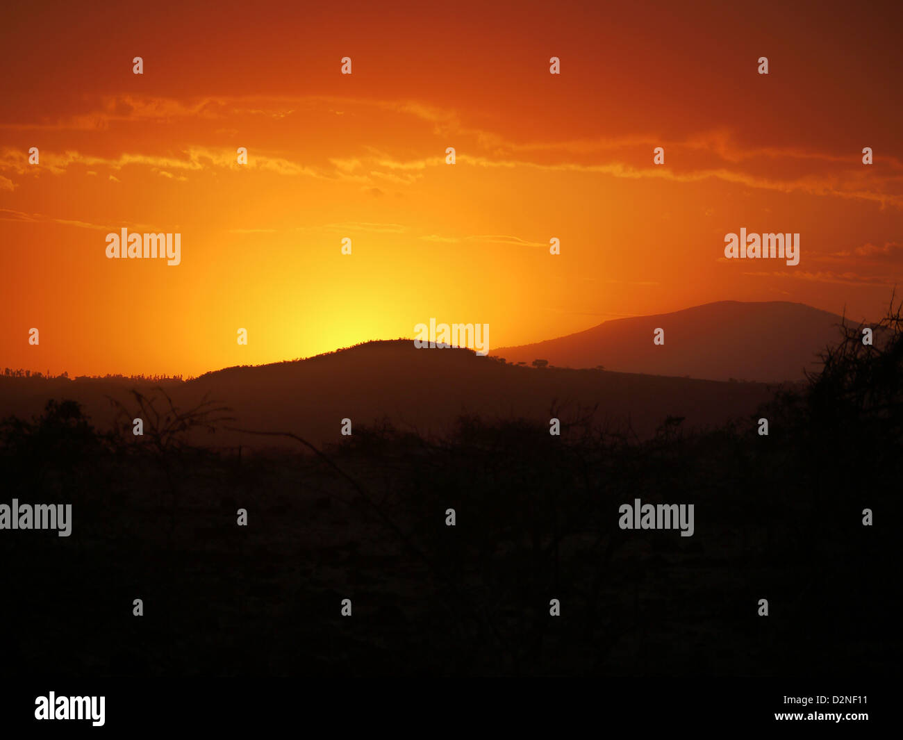Lake Manyara Tanzania Africa sunset color colour   yellow orange fiery glow Red shades colours warm sun sky travel - Stock Image