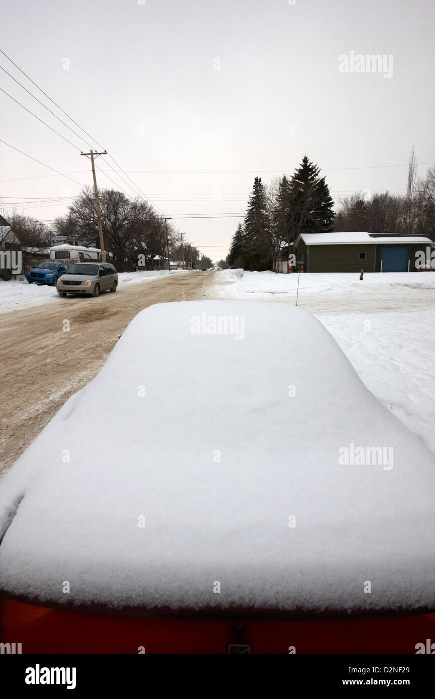 car covered in snow parked by the side of the street pleasant hill Saskatoon Saskatchewan Canada - Stock Image