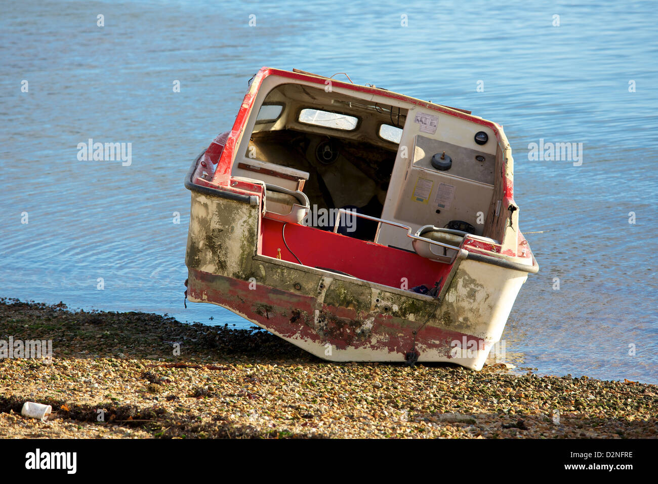 Derelict boat on the sea shore, UK - Stock Image