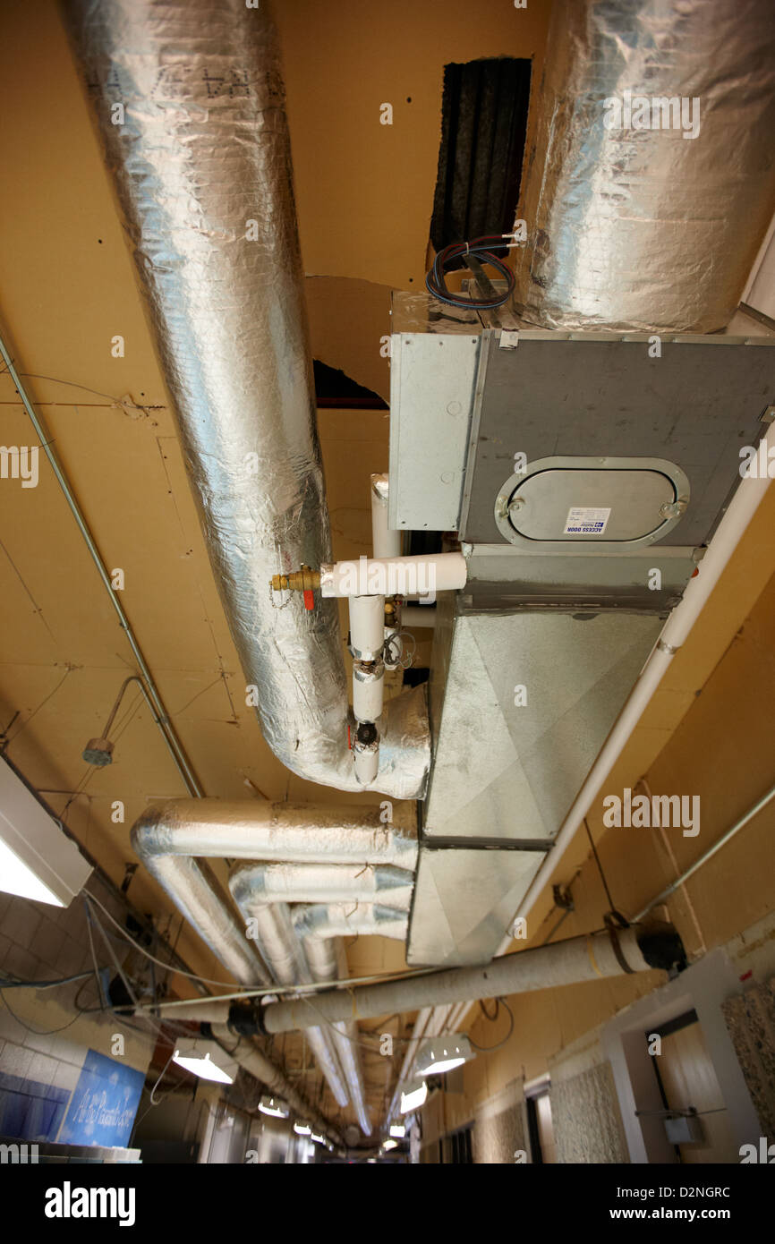 exposed insulated heating and ventilation ducts High school canada north america - Stock Image