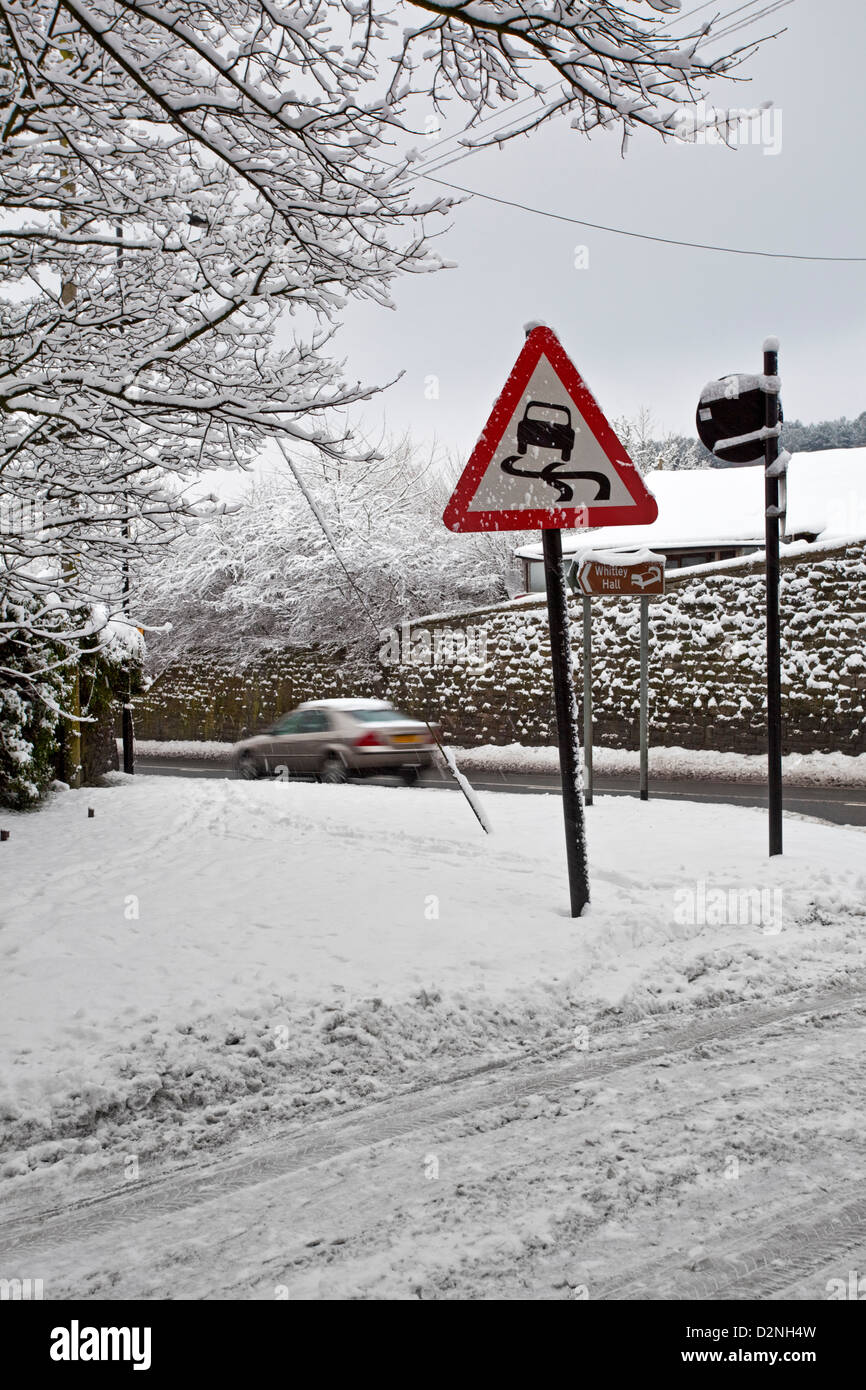 A snow scene at road junction UK - Stock Image