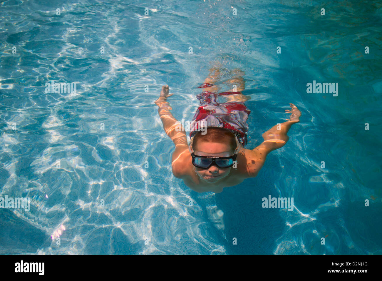 Young child swimming underwater - Stock Image