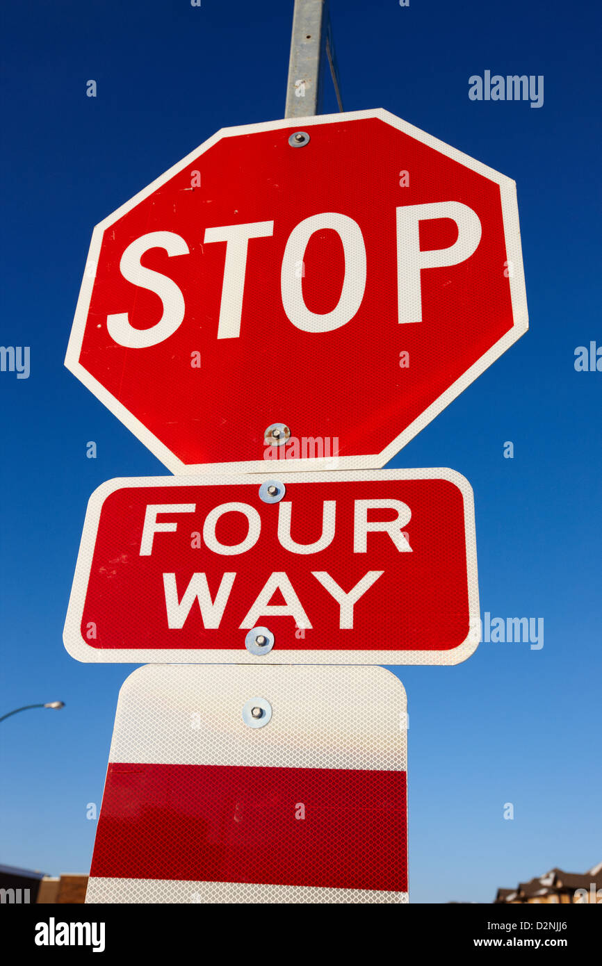 four way stop sign with crosswalk Canada - Stock Image