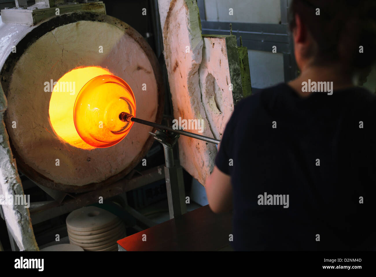 Glass blower at work - Stock Image