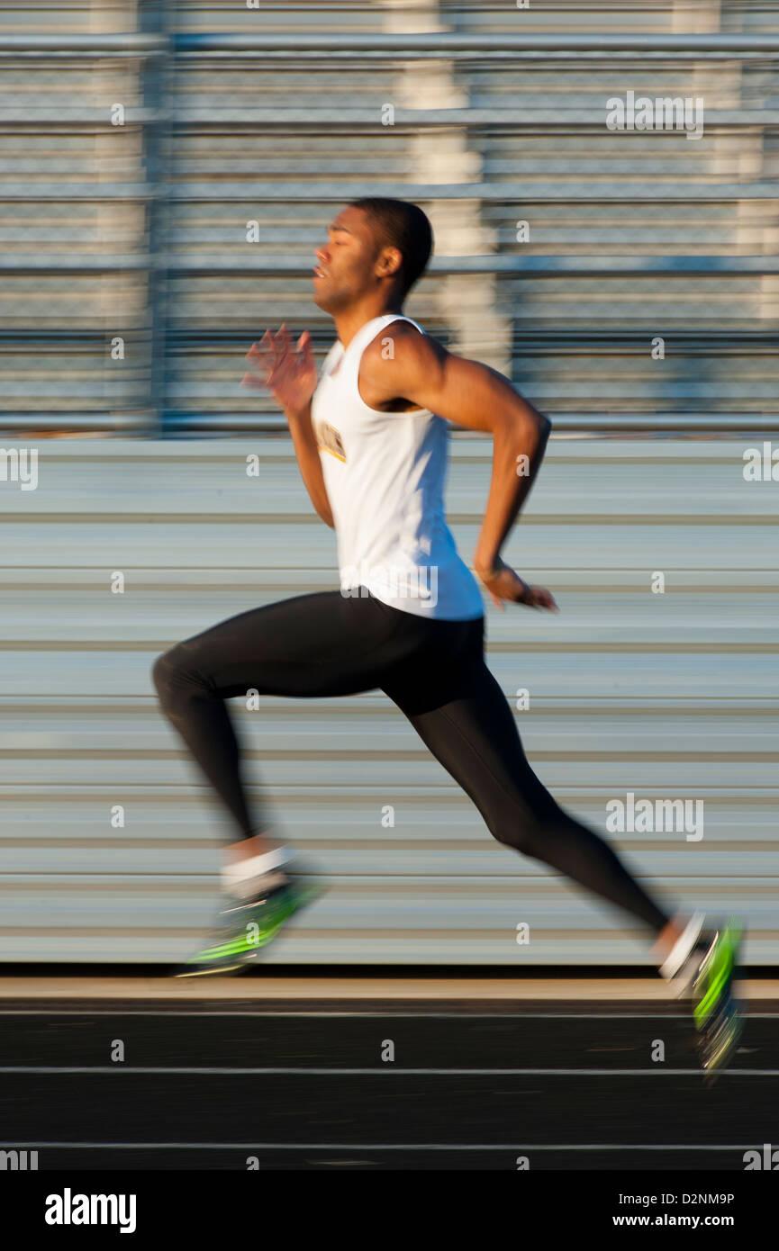 African American Black track runner sprinter in stride - Stock Image