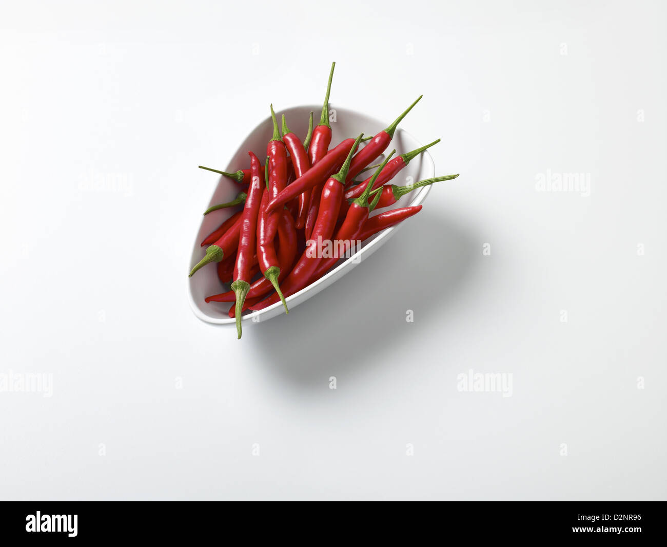 Fresh bowl of red chillies Stock Photo