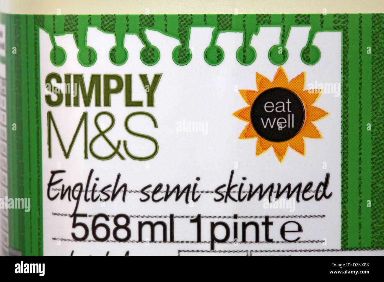 label on 1 pint of Simply M&S English semi skimmed milk - Stock Image