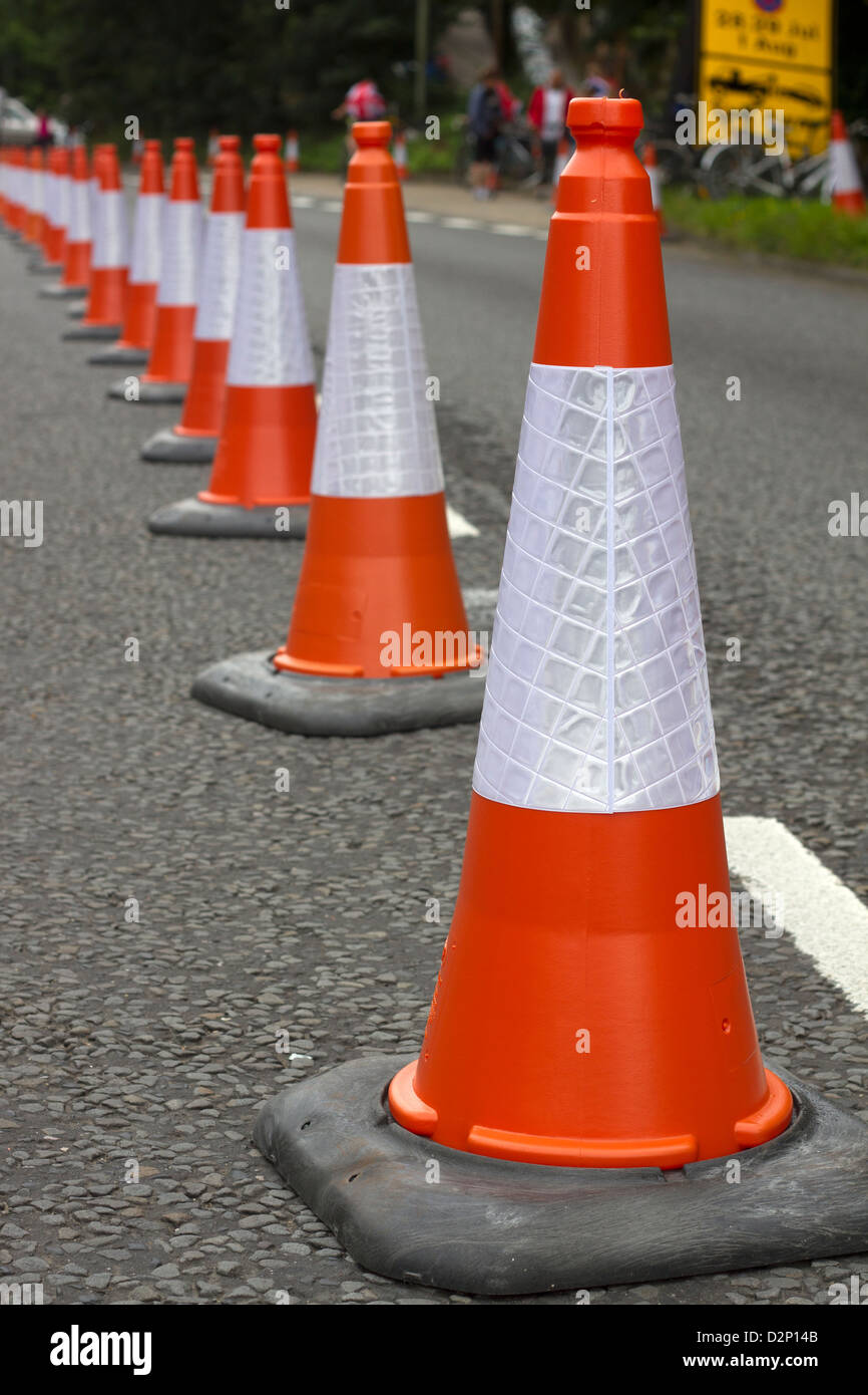 Traffic cones in a line. - Stock Image