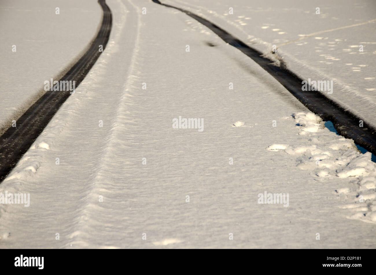 Tyre tracks in snow - Stock Image