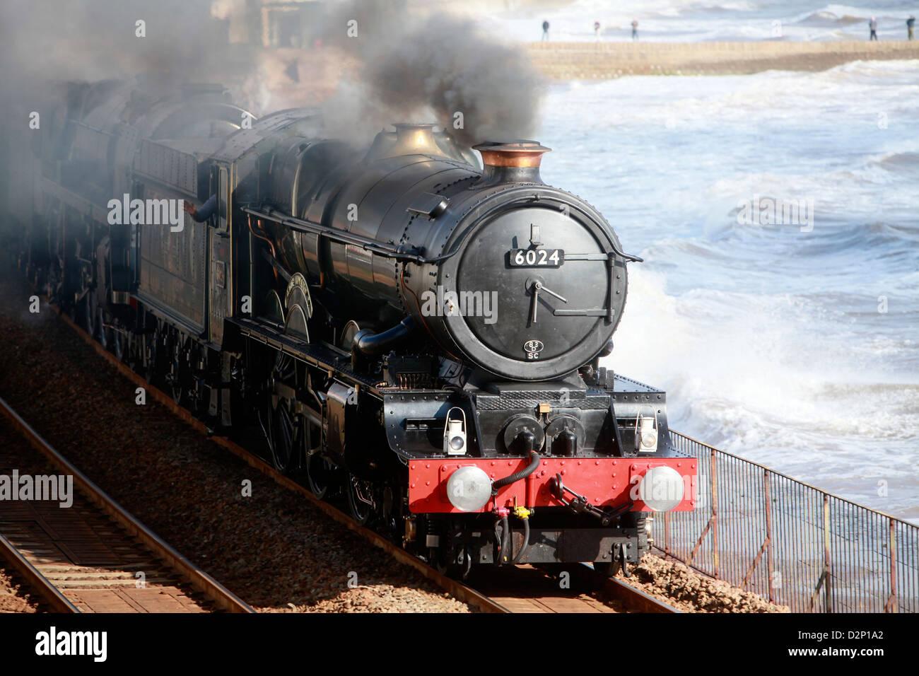 A vintage double header steam locomotive passes through Dawlish on the famous Brunel South Devon coastal railway - Stock Image
