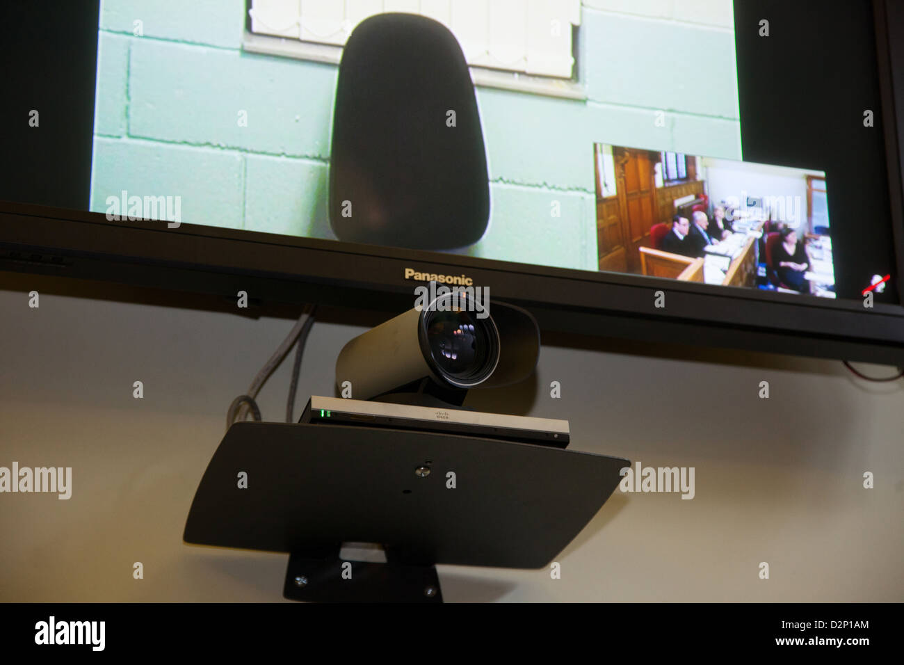 Video link up technology in a court room. Stock Photo