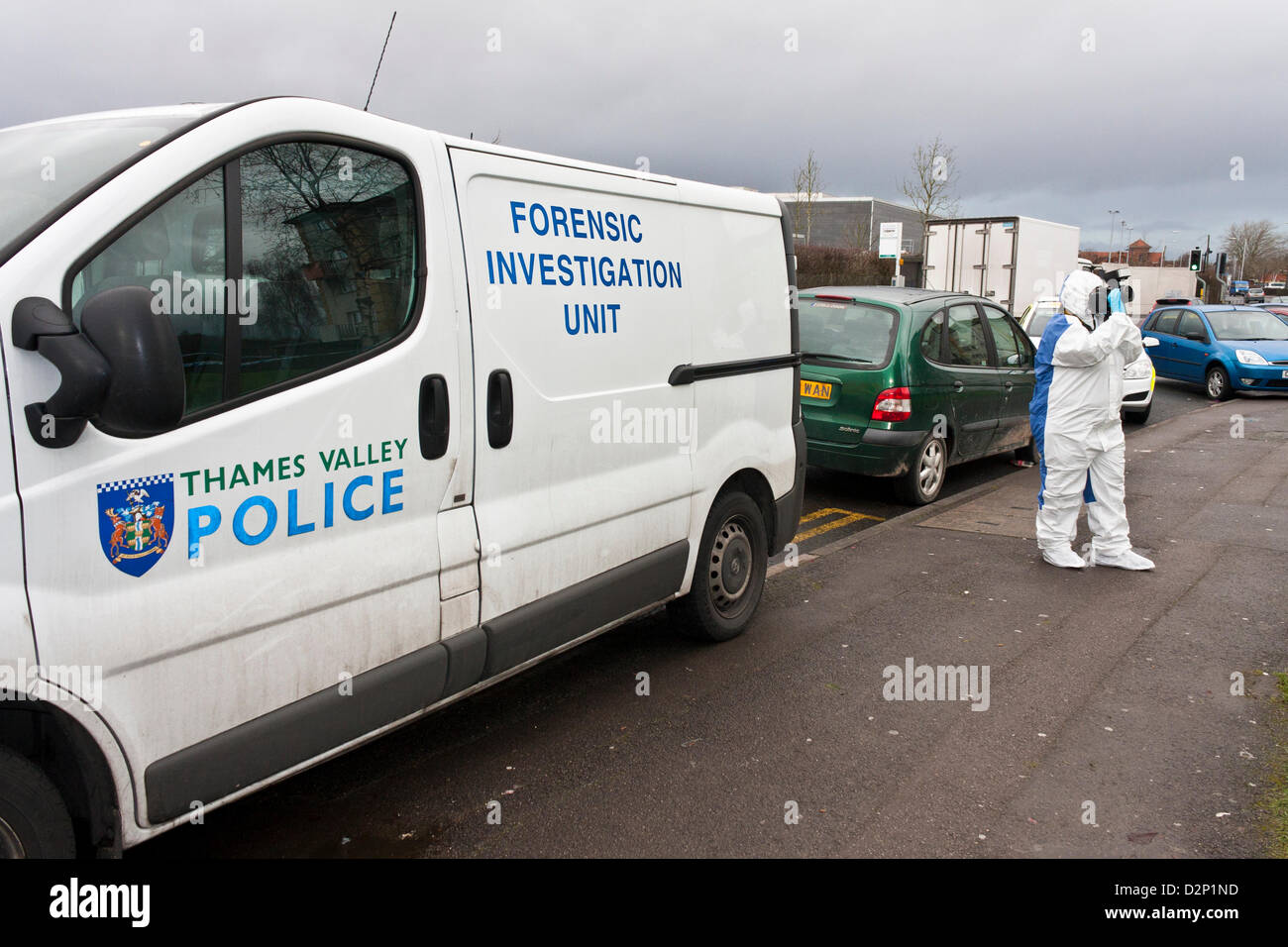 A forensic investigator takes photos at the scene of a crime. - Stock Image