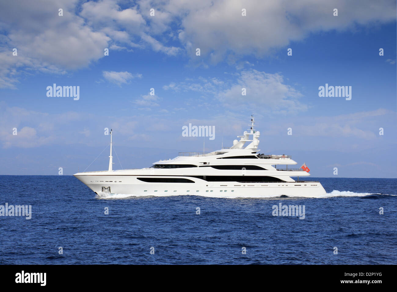 Private yacht sailing in open waters - Stock Image