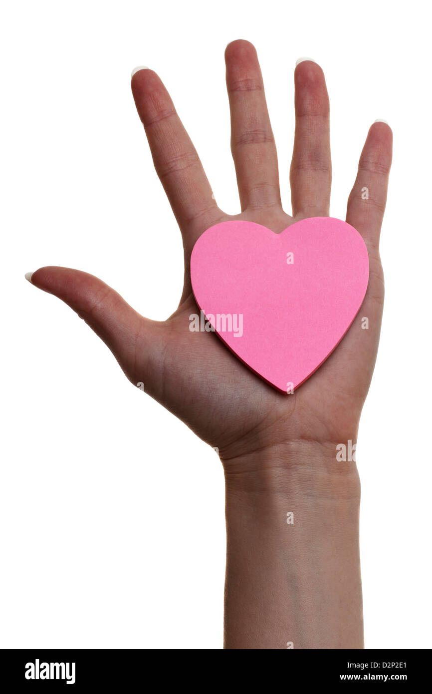 Heart in hand of woman. The hand. - Stock Image