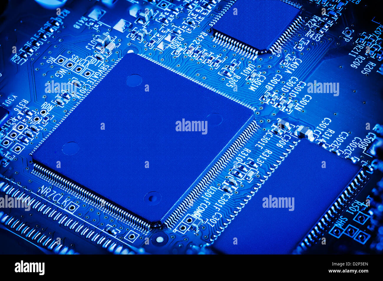 Power Microchip Stock Photos Images Alamy Is The Central Printed Circuit Board Pcb In Many Modern Computers On Blue Close Up Macro Detail Image