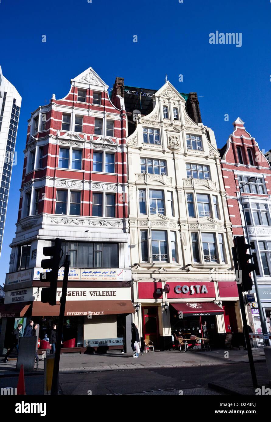 Tall houses on Edgware Road at Paddington, London, England, UK - Stock Image
