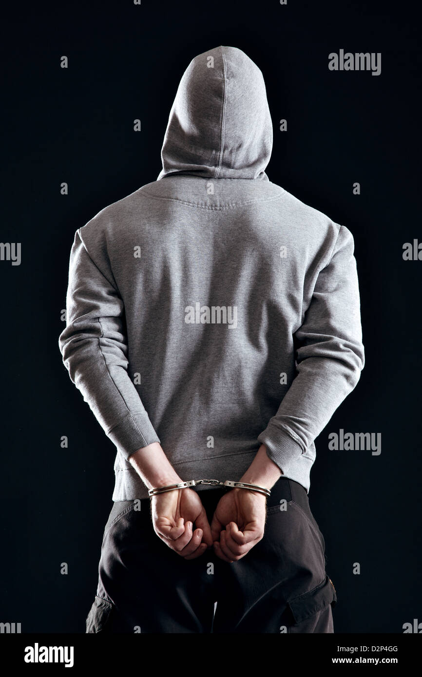 Criminal in handcuffs arrested for his crimes - Stock Image