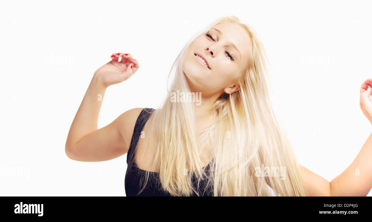 Woman with both arms outstretched enjoying her carefree lifestyle - Stock Image