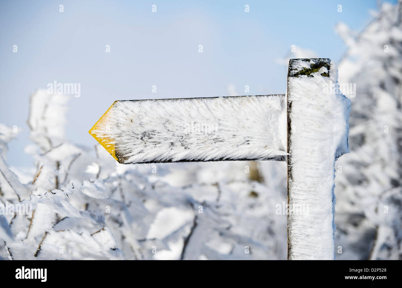 A wind snow frosted footpath sign on Exmoor in Winter, UK - Stock Image