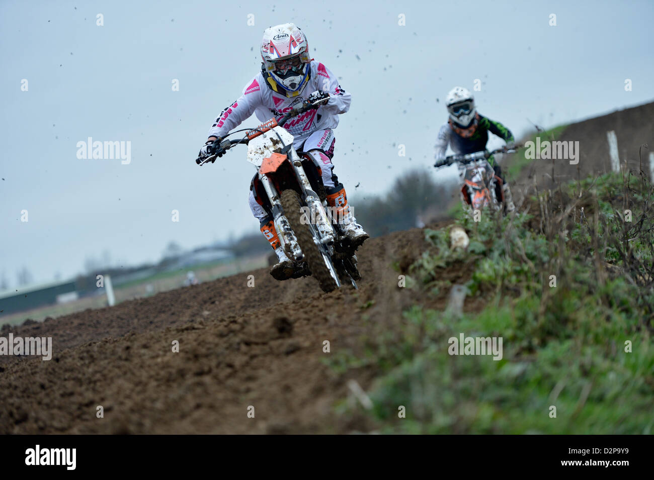 Motocross riders on a motocross built track - Stock Image